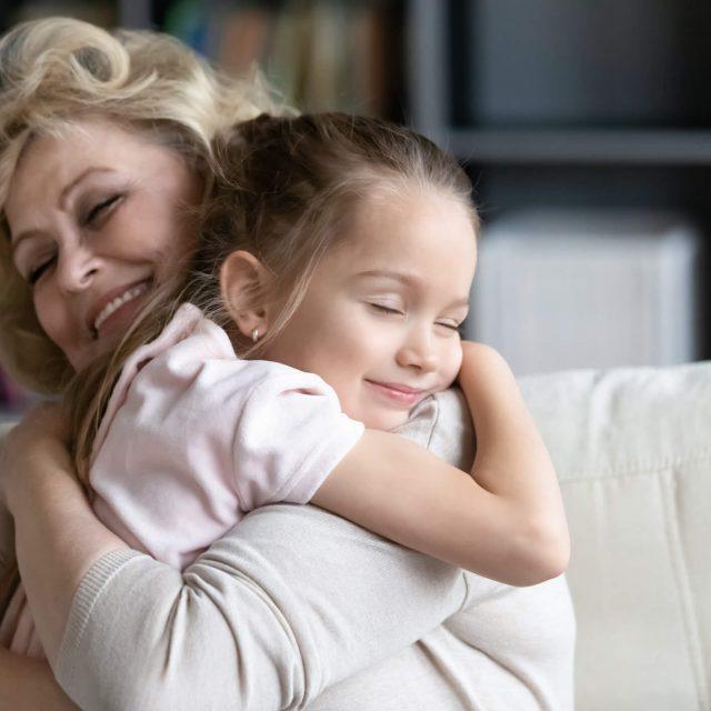 Happy-senior-granny-cuddle-with-cute-preschooler-granddaughter-1212315819_2125x1416