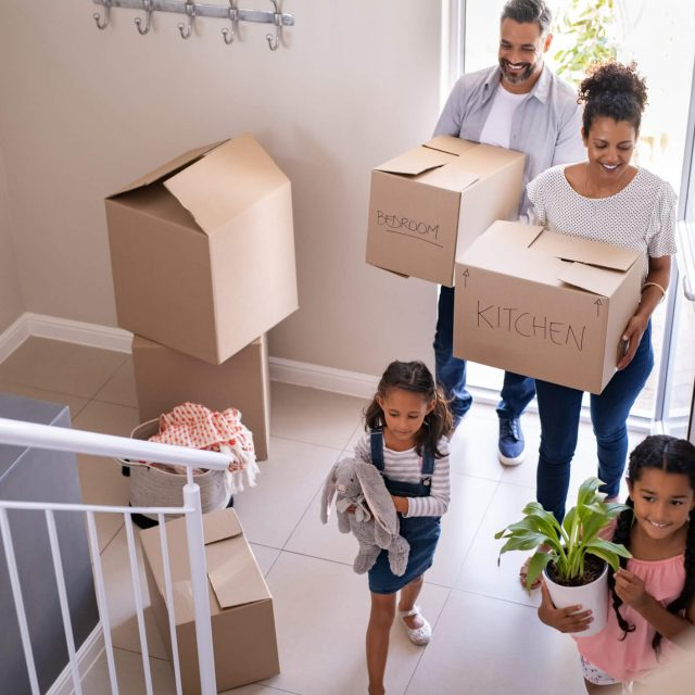 Multiethnic-family-moving-in-new-home-1270070145_2125x1416