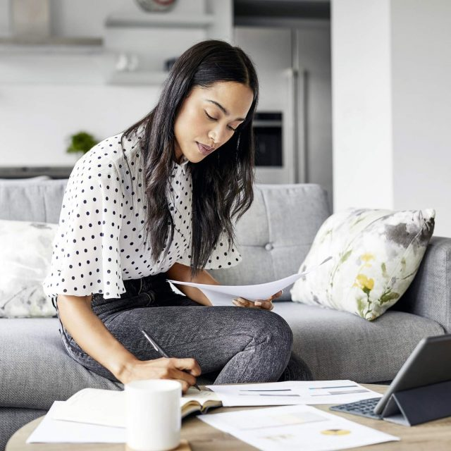 Woman looking at financial documents